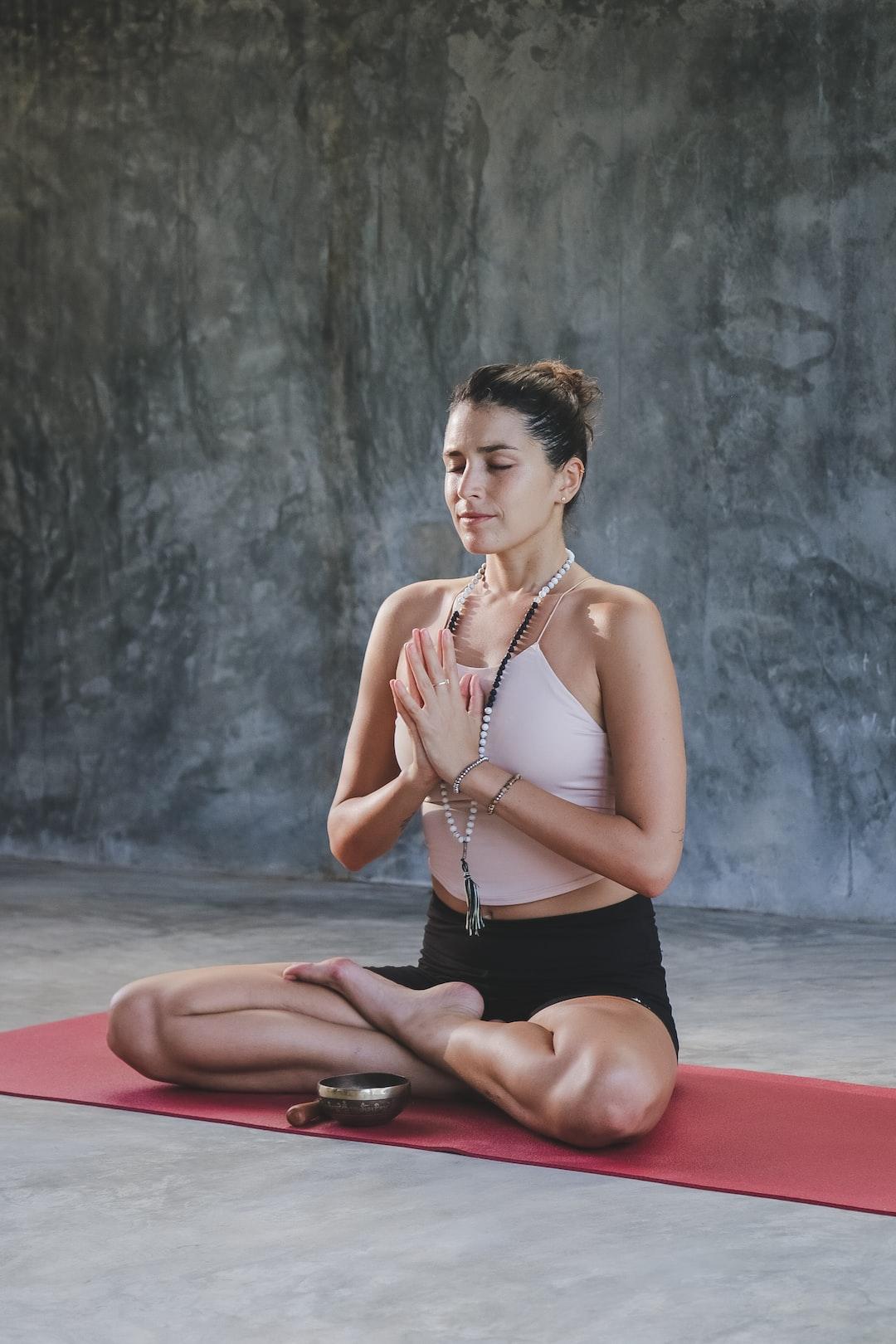 Yoga teacher meditating