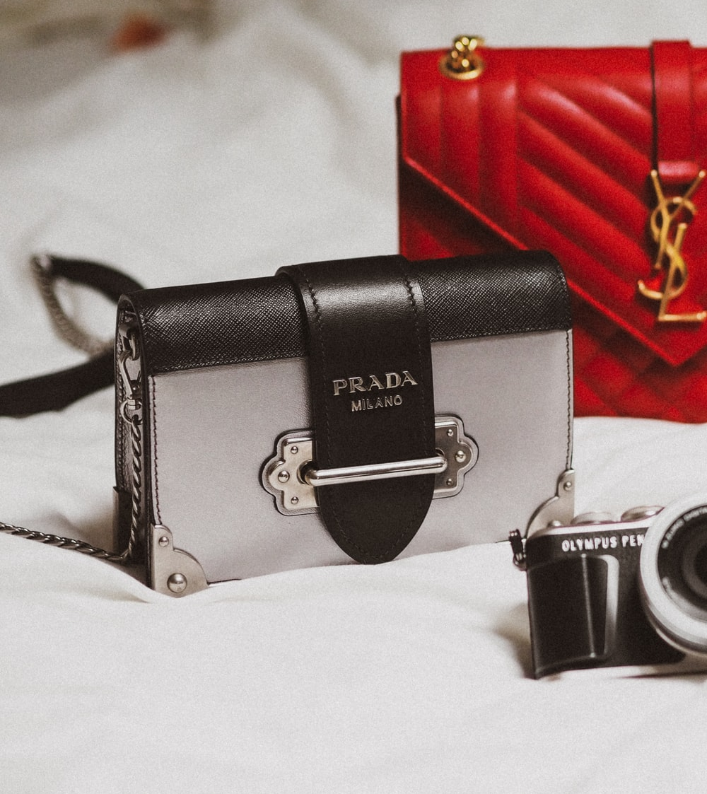 black and silver camera on white textile
