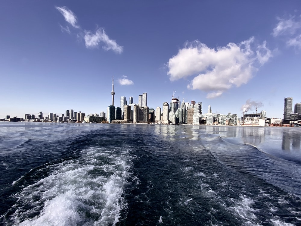 city skyline across body of water during daytime