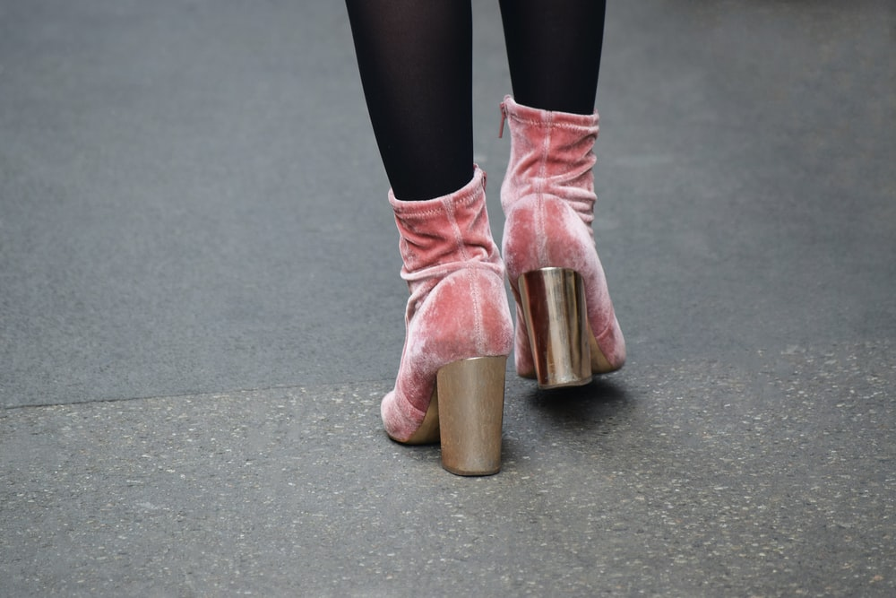 woman in pink leather boots