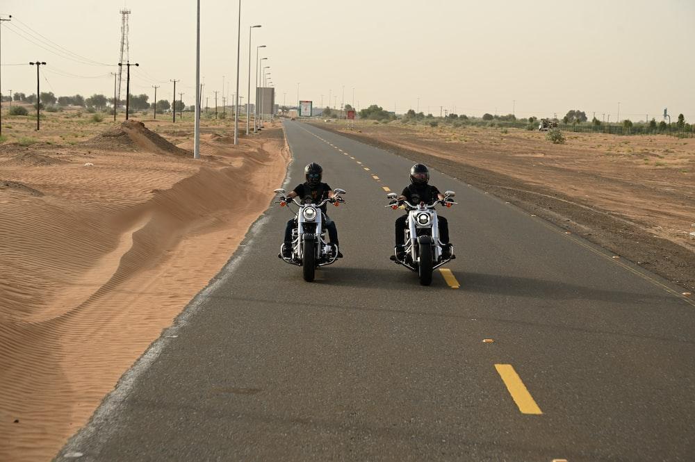 man in black motorcycle on road during daytime