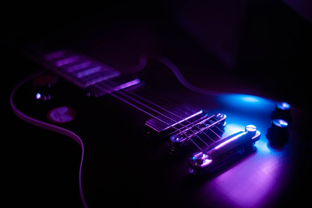 purple and black electric guitar