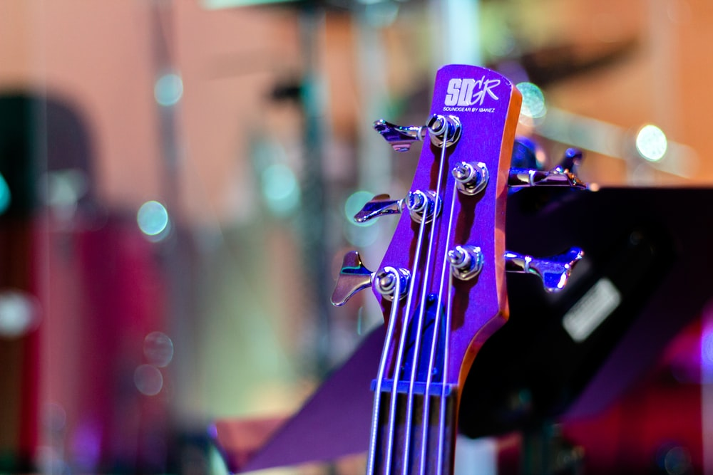 purple and black guitar headstock