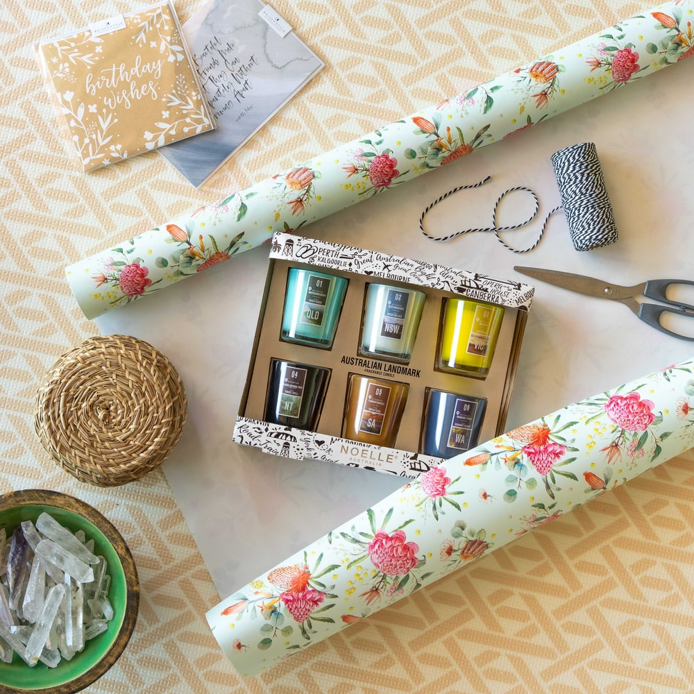 white and green floral gift wrapper