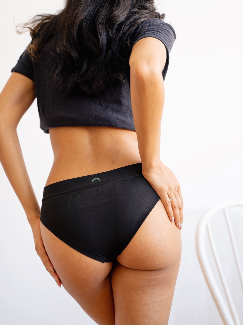 woman in black crop top and black panty