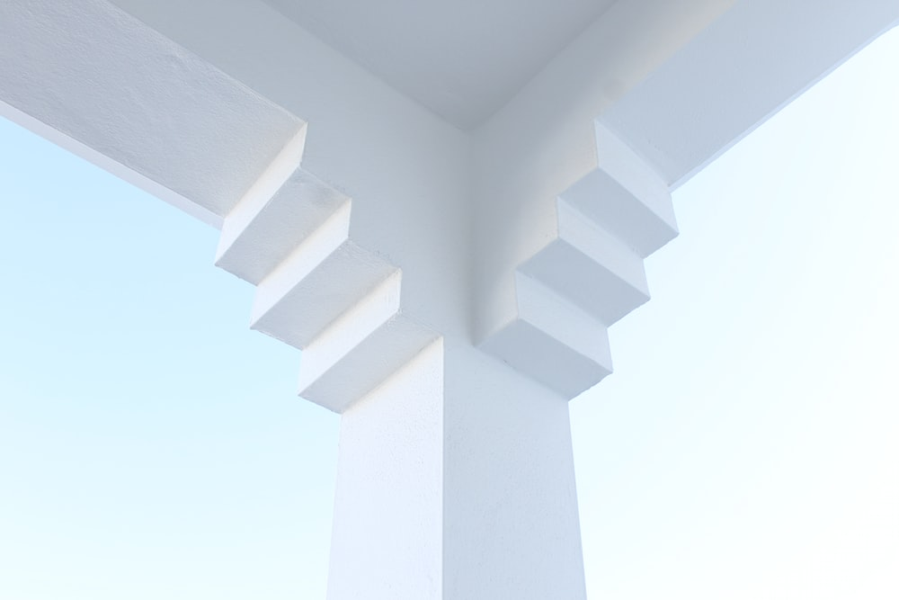white concrete cross with white background