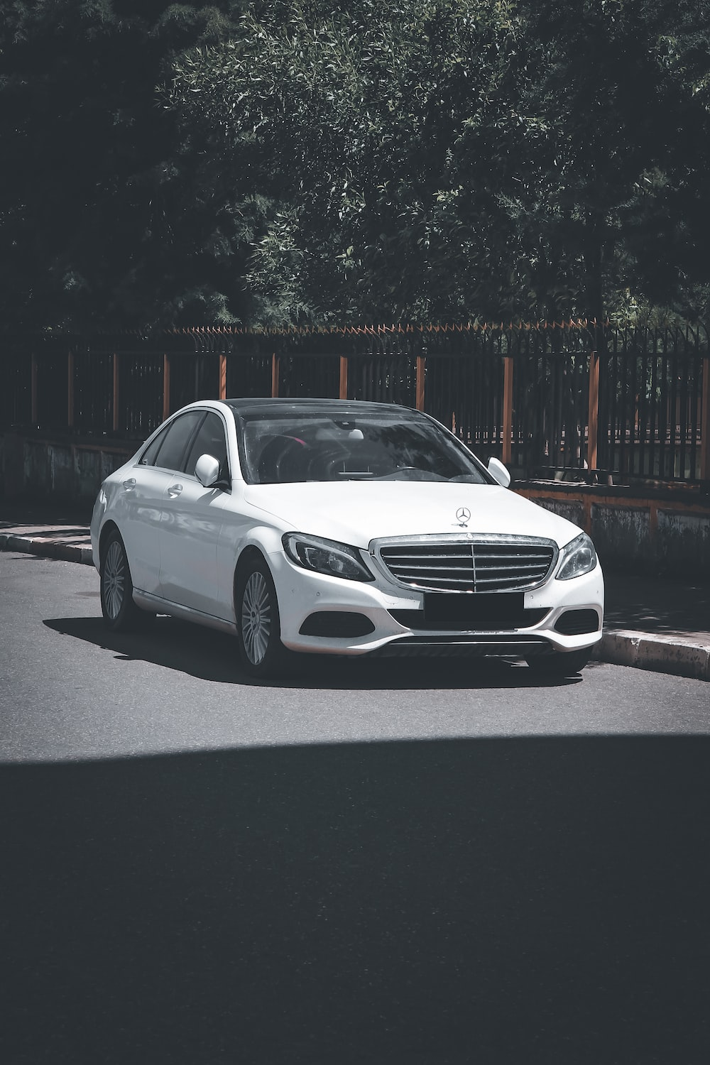 white mercedes benz coupe on road during night time