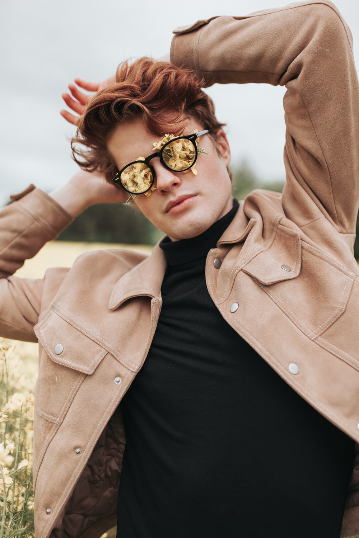 woman in brown coat wearing black sunglasses