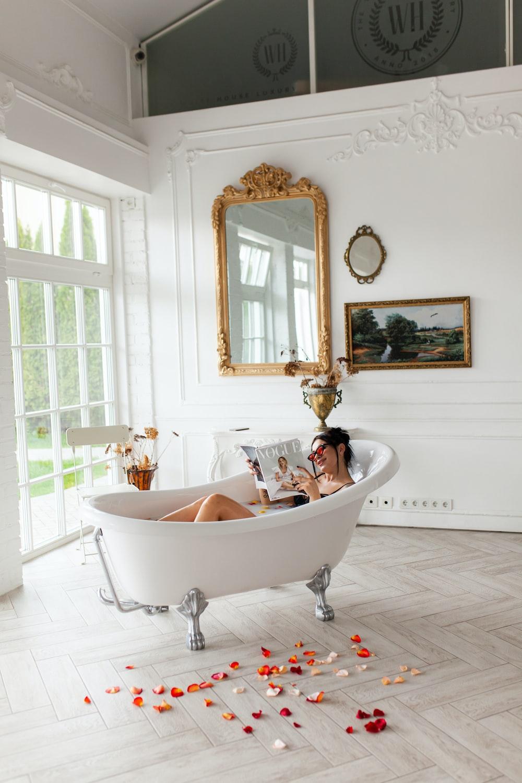 woman in bathtub with mirror