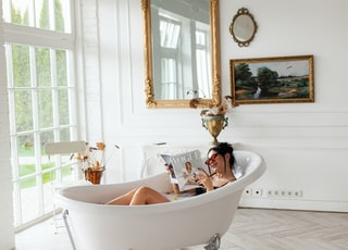 woman in bathtub with mirror