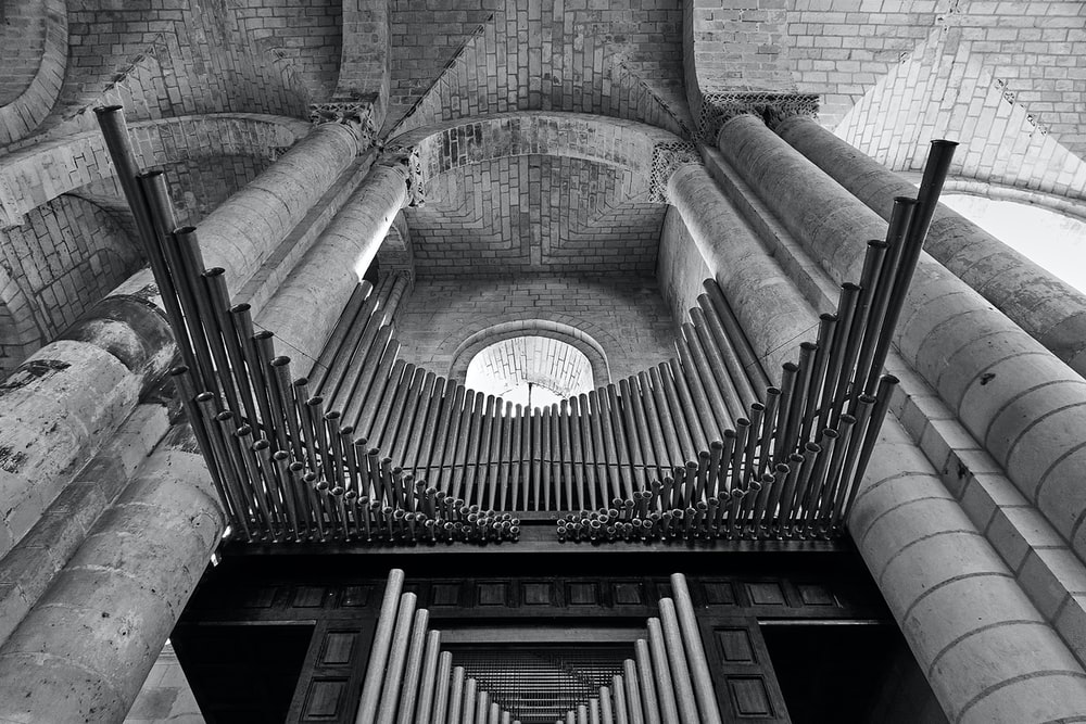 grayscale photo of concrete spiral staircase