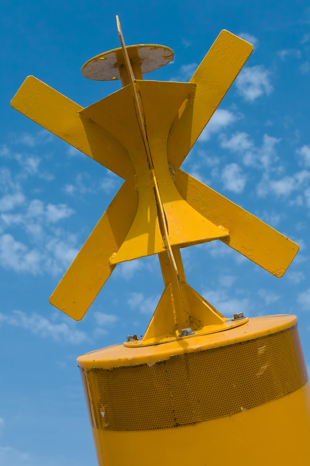 yellow and brown windmill under blue sky during daytime
