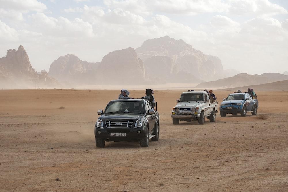 black car on brown sand during daytime