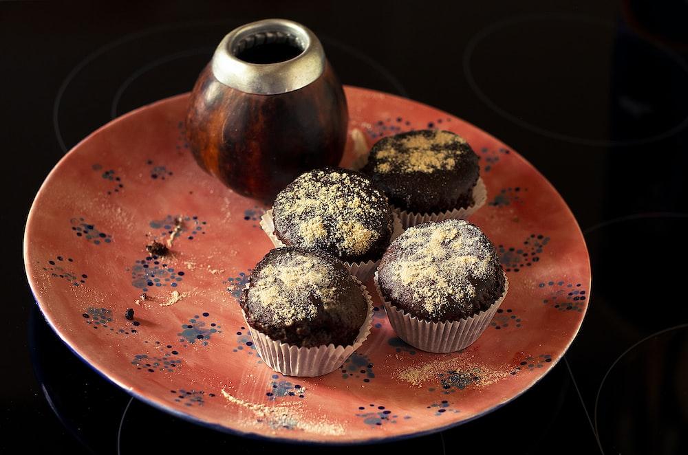 cupcakes on orange ceramic plate