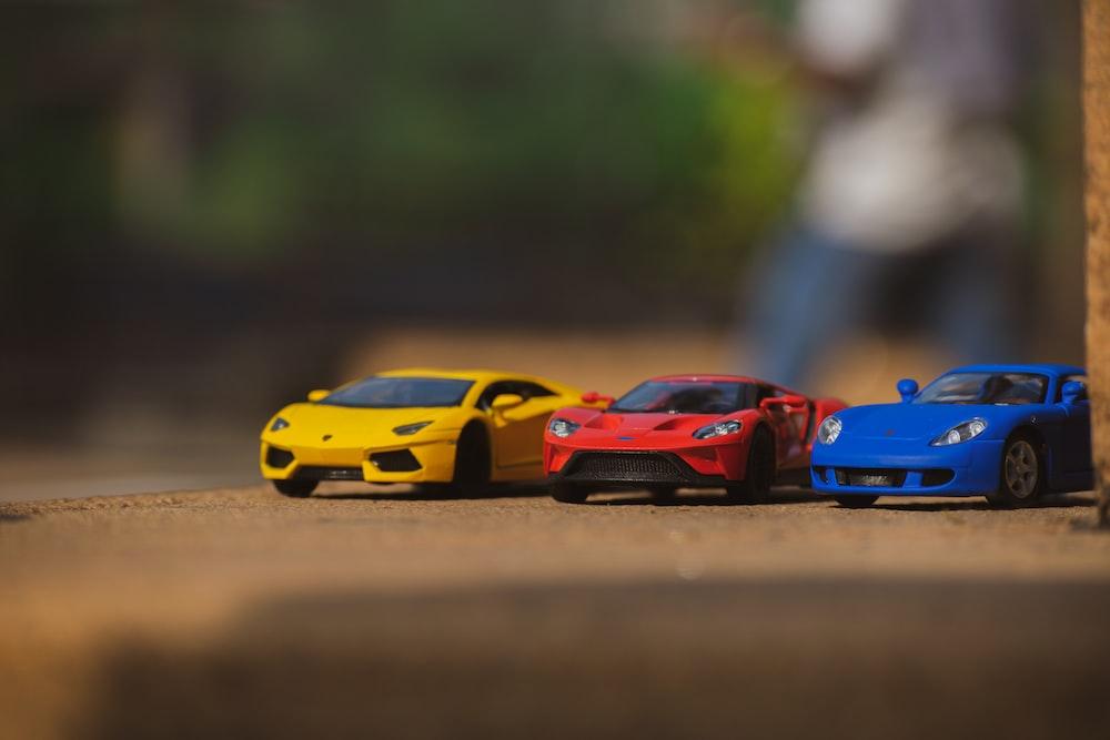 blue and orange lamborghini aventador scale model