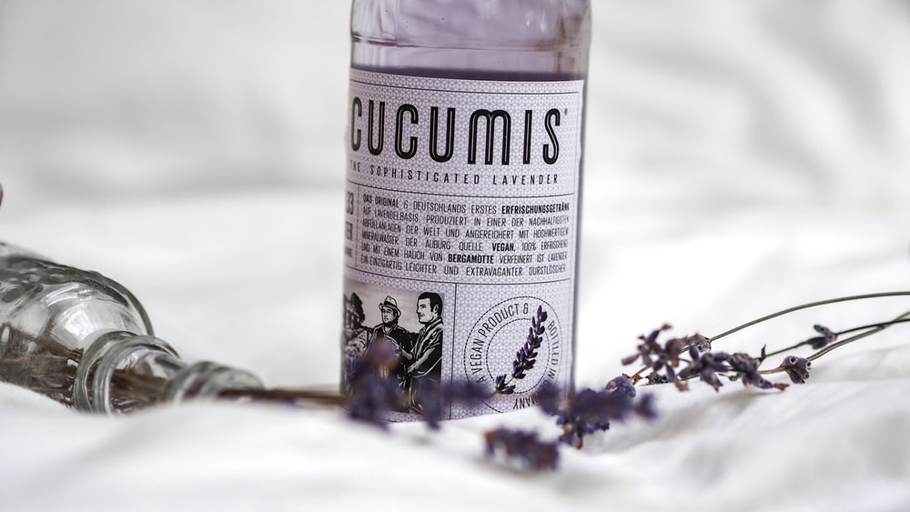 white and purple labeled bottle