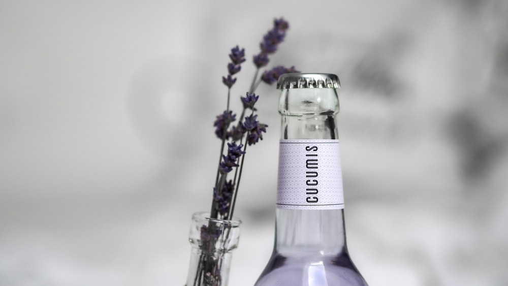 purple and white labeled bottle