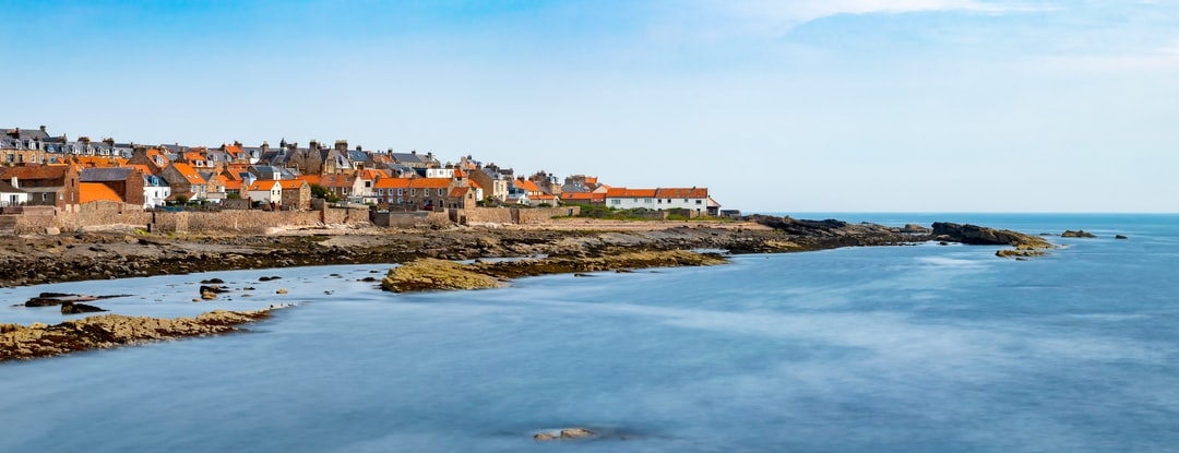 Anstruther and Cellardyke, East Neuk of Fife, Scotland. A view along the coastline.  Summer afternoon sunshine.