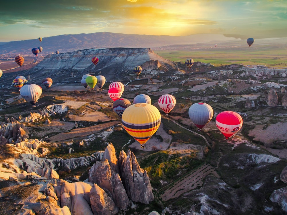 hot air balloons on the top of the mountain