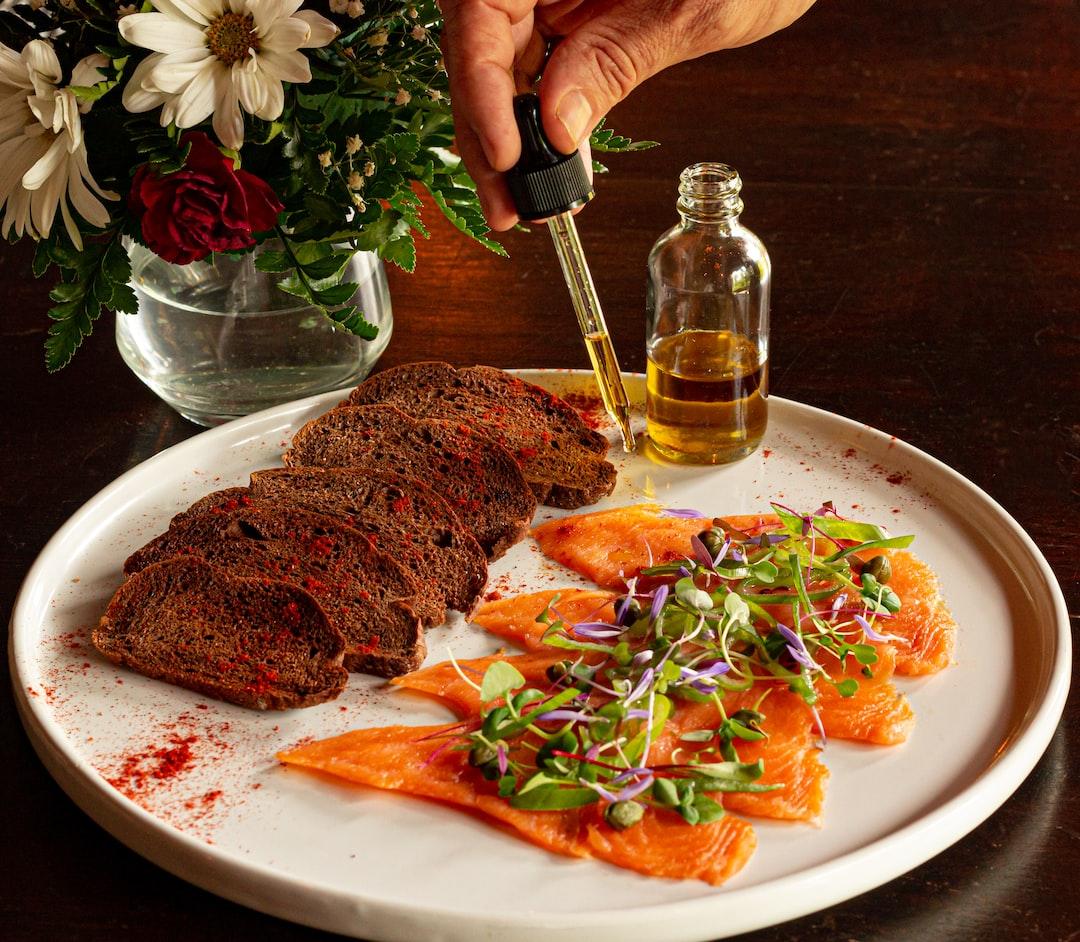 Salmon carpaccio with seasoned oil