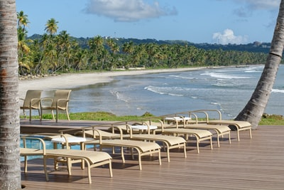 white and gray chairs on seashore during daytime trinidad and tobago zoom background