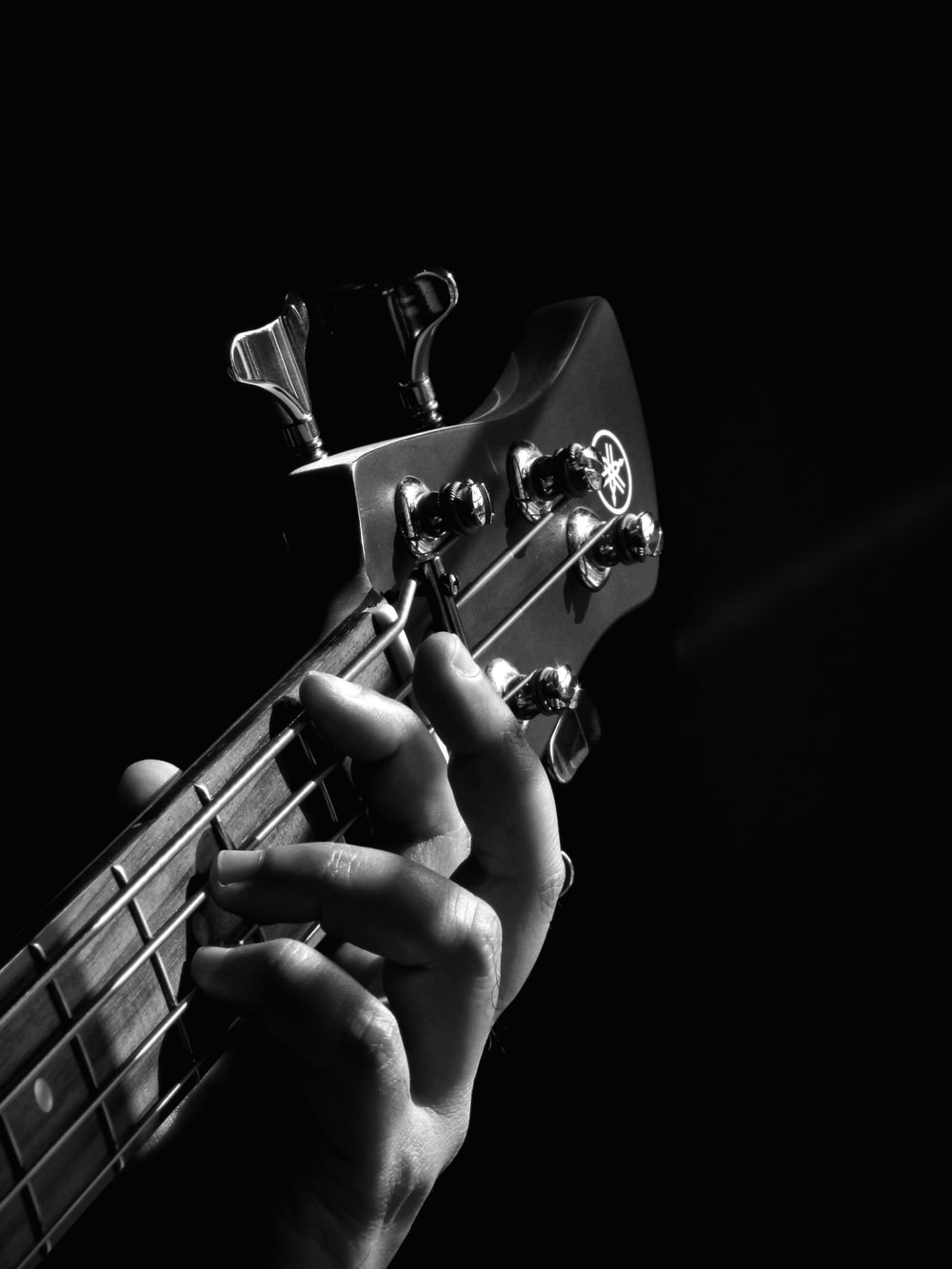 person playing guitar grayscale photo