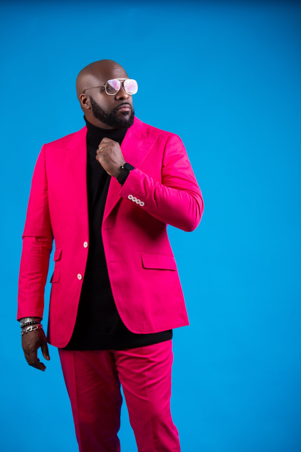 man in pink suit wearing sunglasses