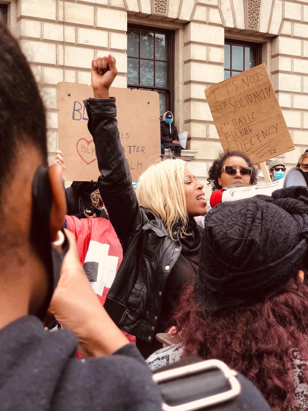 woman in black jacket standing near woman in black jacket