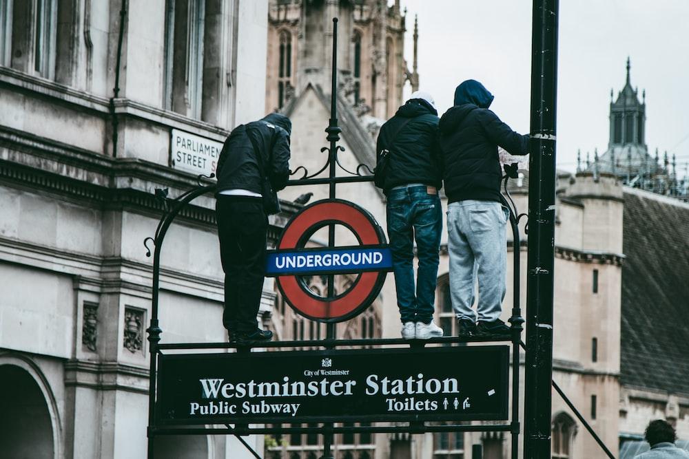 man in blue denim jacket standing beside man in blue jacket