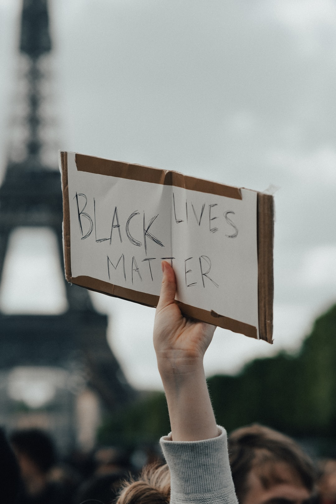Black lives matter sign with the Eiffel Tower in the background
