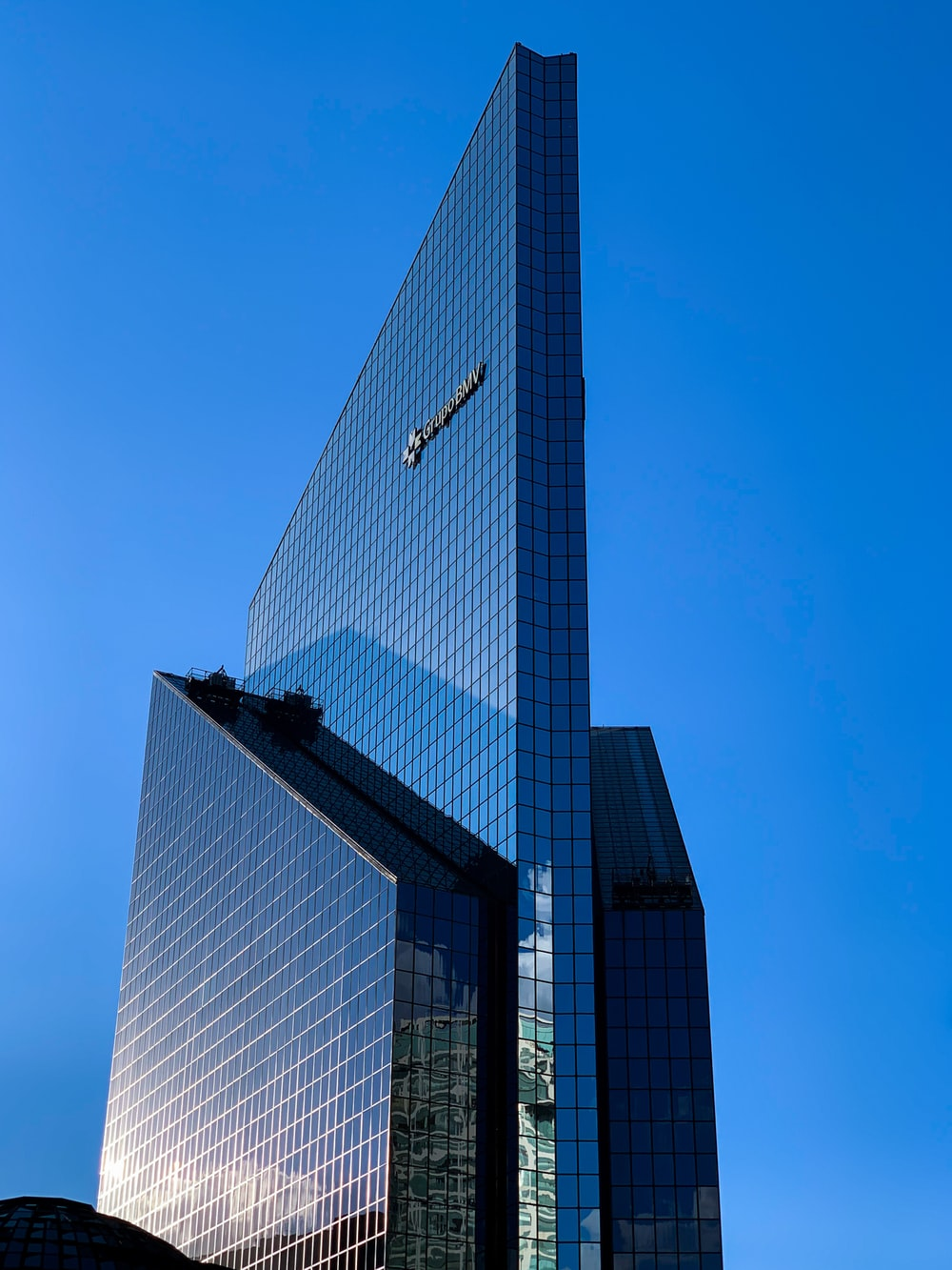 black and white glass building under blue sky during daytime