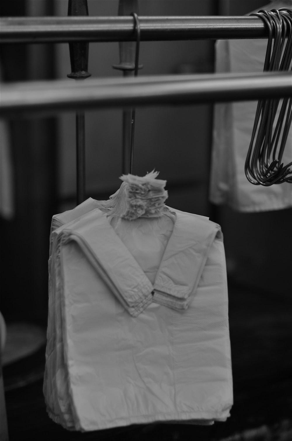 grayscale photo of dress shirt