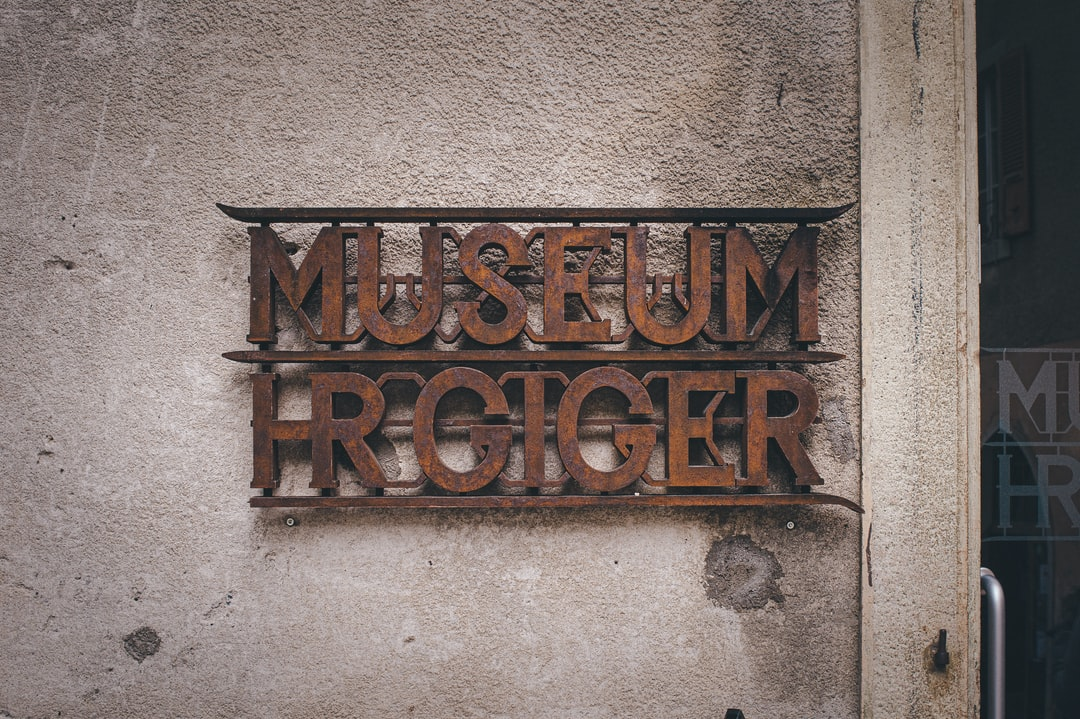 HR Giger Museum signboard is made of rusted metal.