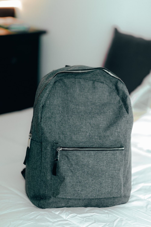 black backpack on white textile