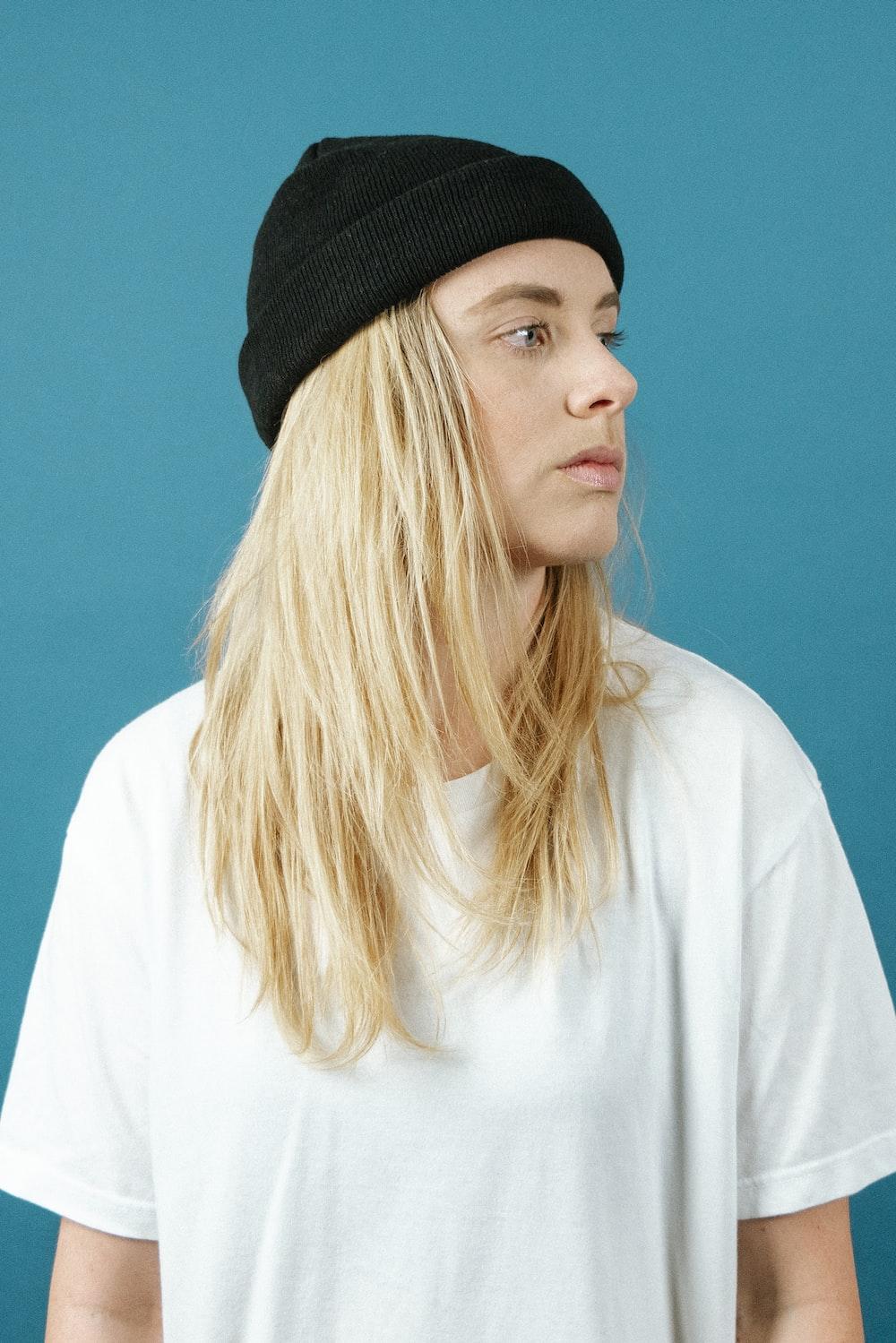 woman in white shirt wearing black knit cap