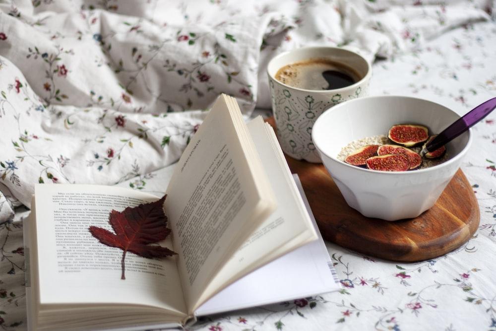 white ceramic bowl on white book page