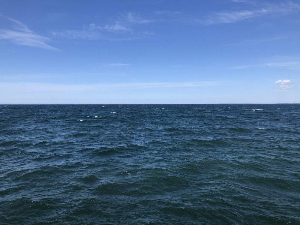 blue ocean under blue sky during daytime