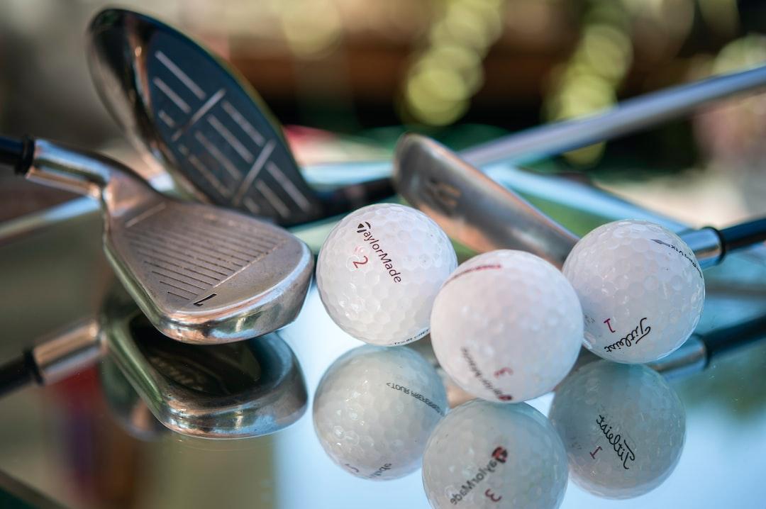 Golf clubs and balls shot close up.