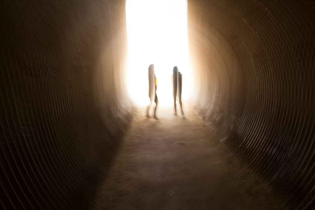 two girls in a tunnel
