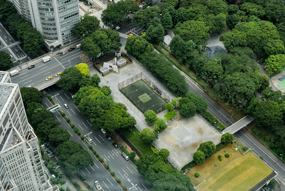 aerial view of city buildings and trees during daytime