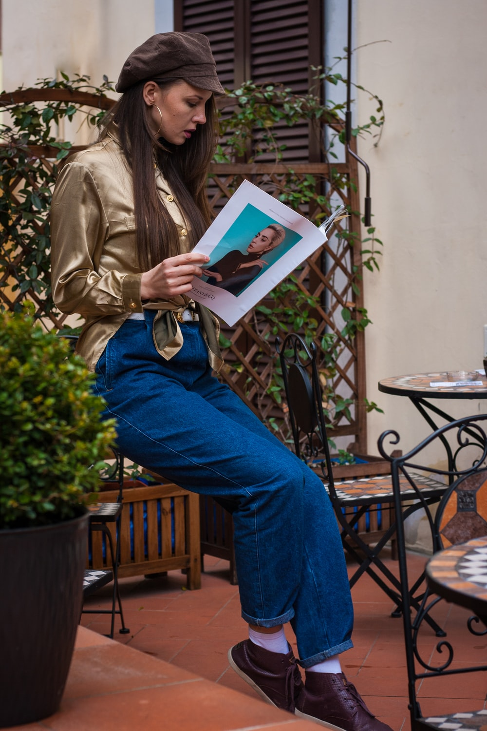 person in blue denim jeans holding blue book