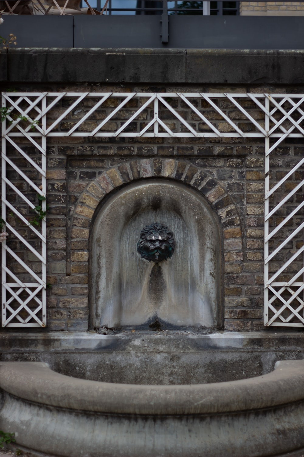 grey concrete arch with water fountain