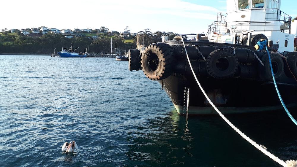 black ship on sea during daytime