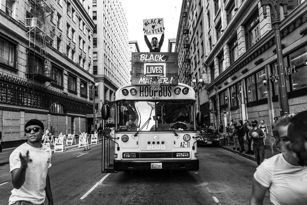 grayscale photo of double decker bus on road