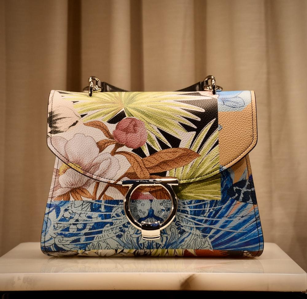 blue and brown floral leather handbag