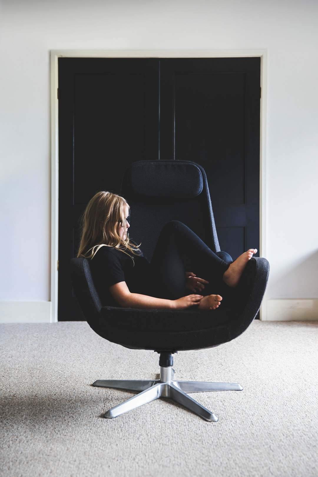 Girls in black chair and black doors