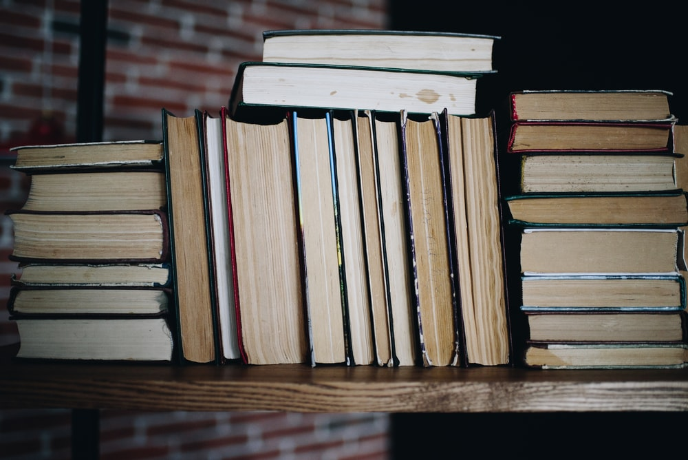 brown wooden books on brown wooden table
