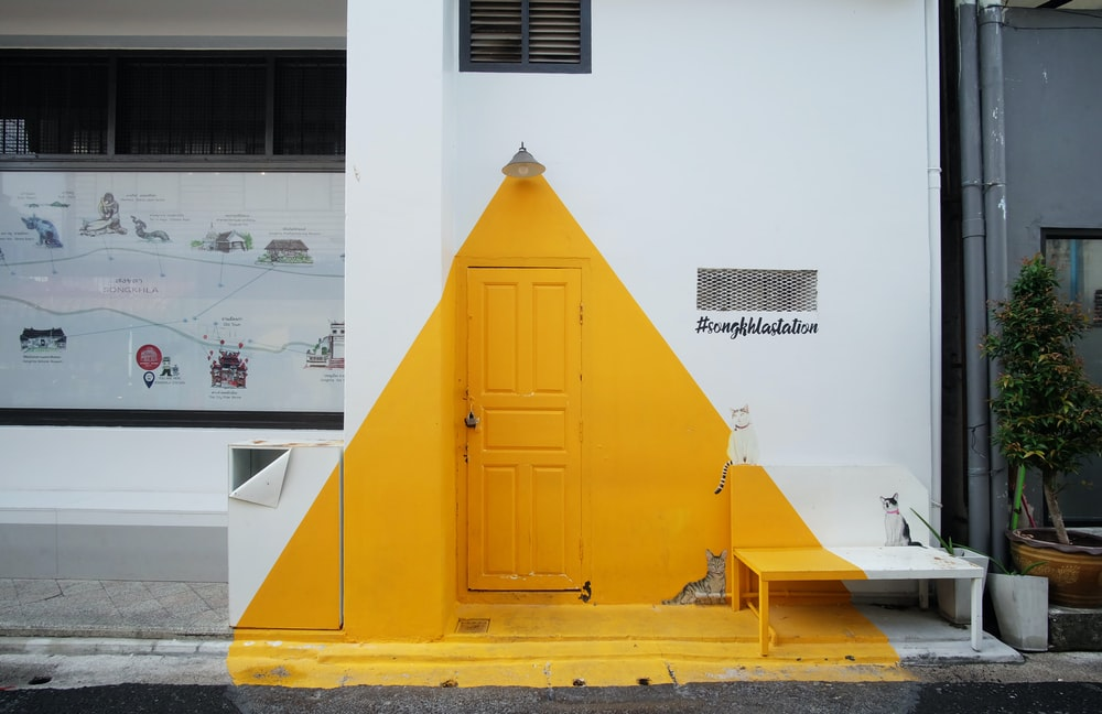 yellow and white concrete building