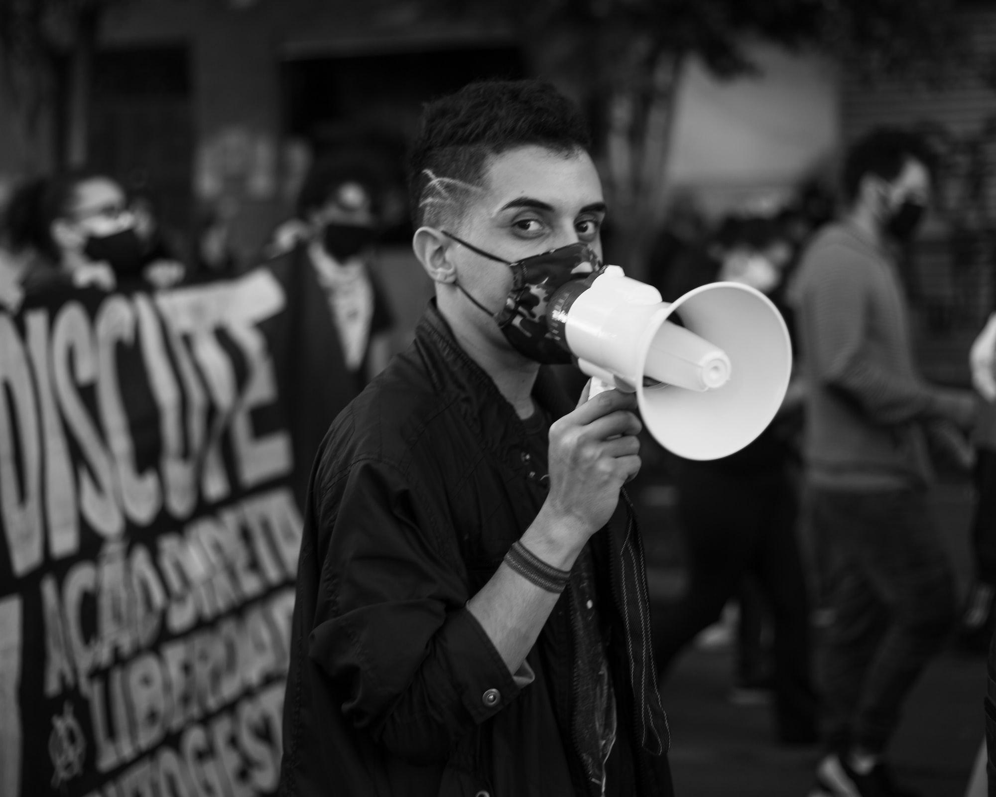protester holding megaphone
