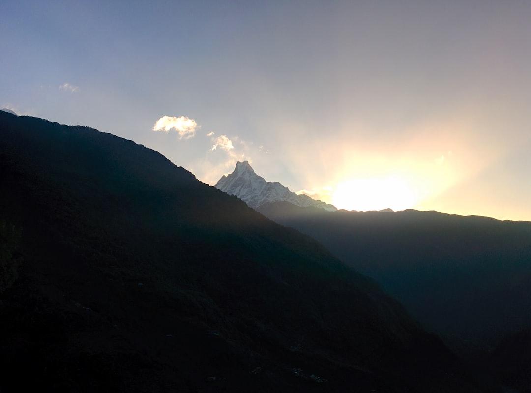 Fishtail mountain (Machhapuchhre) rising between the hills of Tadapani, Nepal during sunset